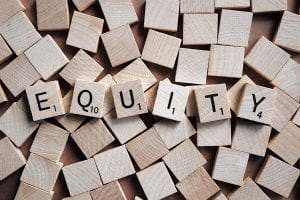 Image: Equity spelled out in Scrabble letters.