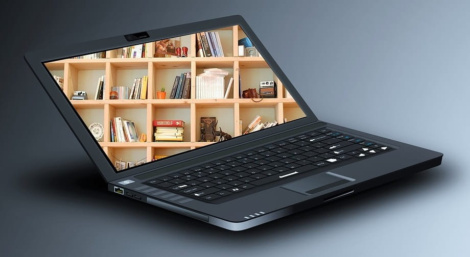 Image of Laptop with Bookshelves on the Screen
