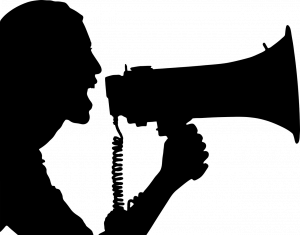 Silhouette Image of Woman Shouting into a Bullhorn