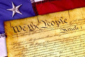 "Image: ""We the People"" U.S. Constitution flanked by the U.S. flag"
