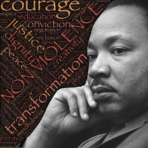 Photograph of Dr. Martin Luther King, Jr. and word art: courage, justice, nonviolence, transformation and more