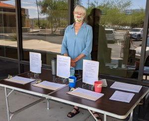 Judi Moreillon gathering signatures outisde public library branch